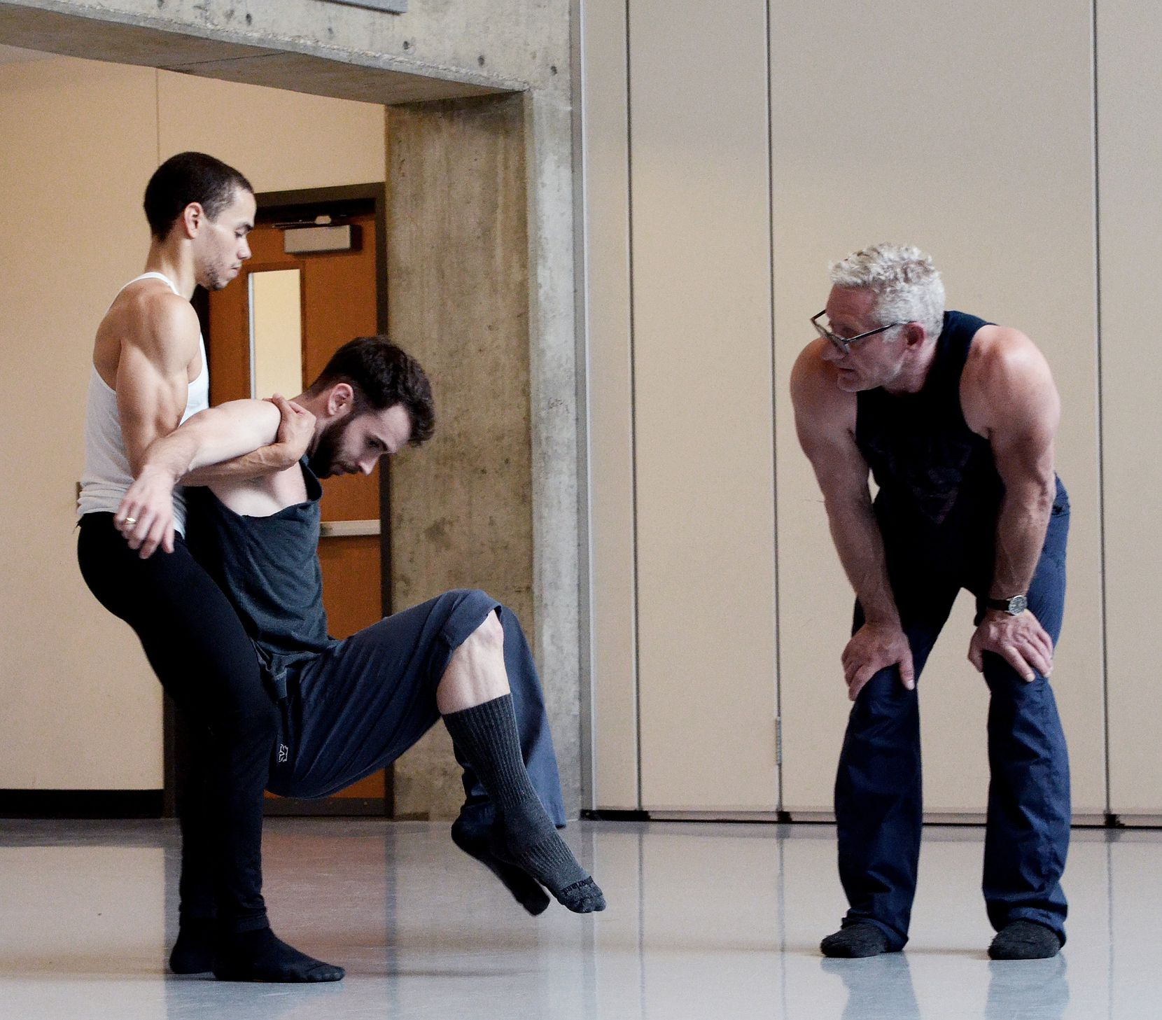 Albert Drake (from left) and Ben Needham-Wood rehearse with choreographer Bruce Wood.