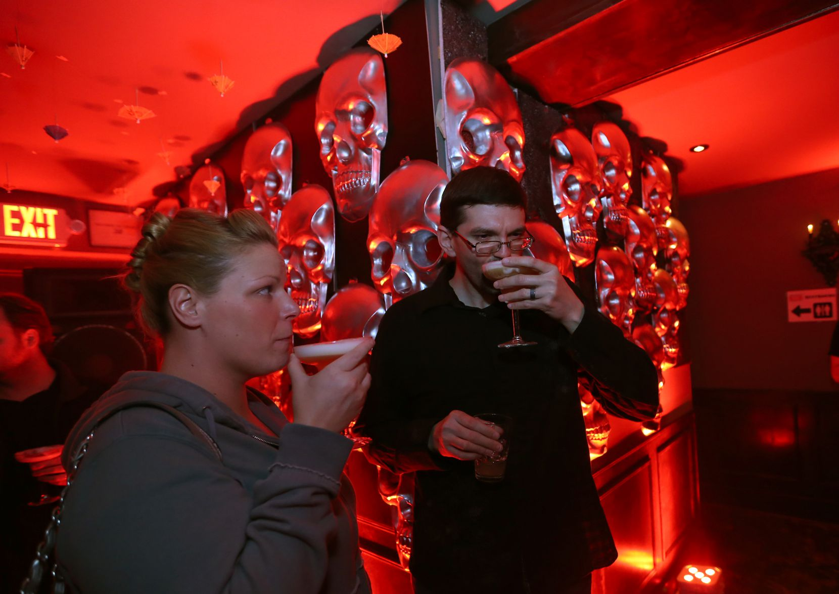 Lynn and Shawn Guenther drink in the pop-up Botty Bar & Half Mast Tiki Lounge at Henry's Majestic  during a Trigger's Toys event in 2014.