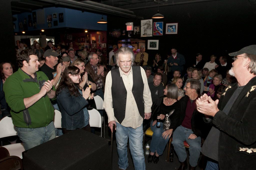 Guy Clark received a standing ovation as he made his way to the stage during Poor David's Pub's 35th anniversary celebration in 2012.
