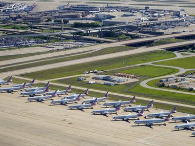 Aerial view of some of the 25 American Airlines aircraft parked on the ramp to the south of Terminal D at Dallas Fort Worth (DFW) International Airport on Thursday, April 16, 2020. (Smiley N. Pool/The Dallas Morning News)