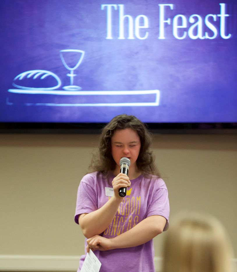 """Constance Lewis practices reciting a prayer before """"The Feast"""" church service for people with special needs at Highland Park United Methodist Church on Sunday, January 8, 2017."""