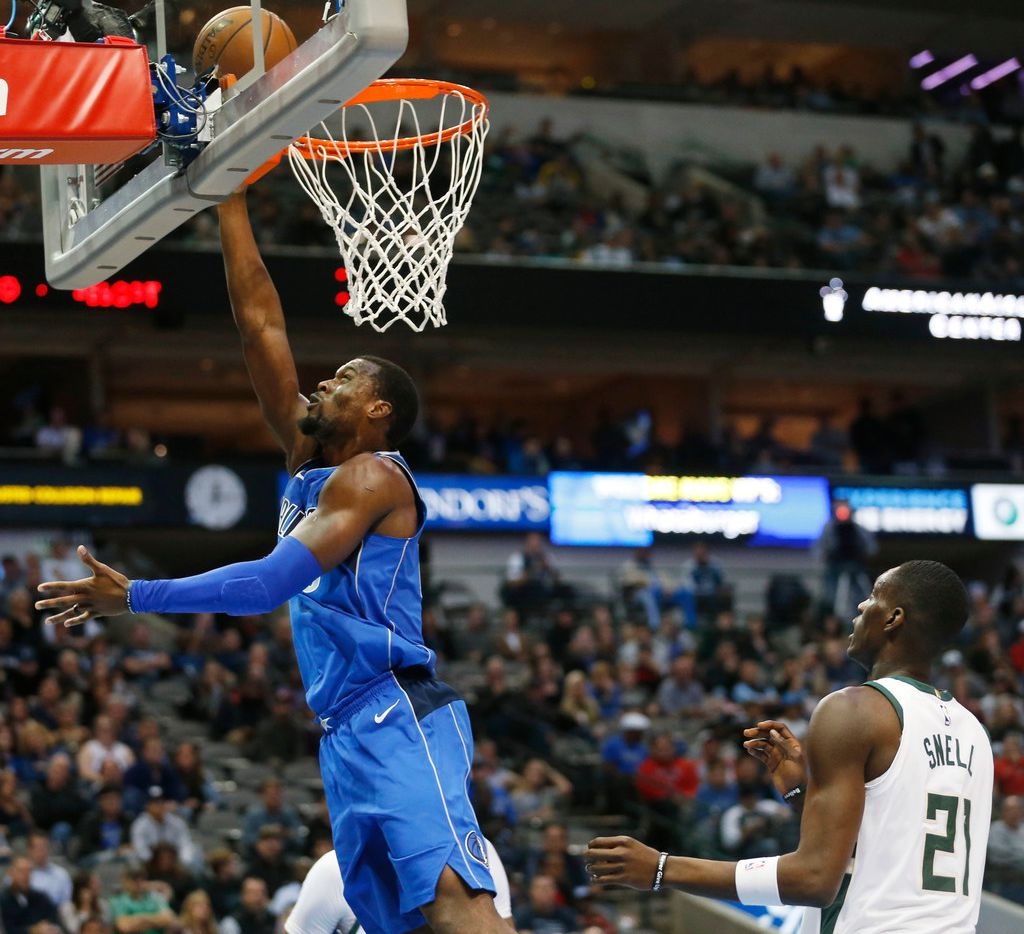 Dallas Mavericks forward Harrison Barnes (40) attempts a layup in front of Milwaukee Bucks guard Tony Snell (21) during the first half of play at American Airlines Arena in Dallas on Saturday, November 18, 2017. (Vernon Bryant/The Dallas Morning News)