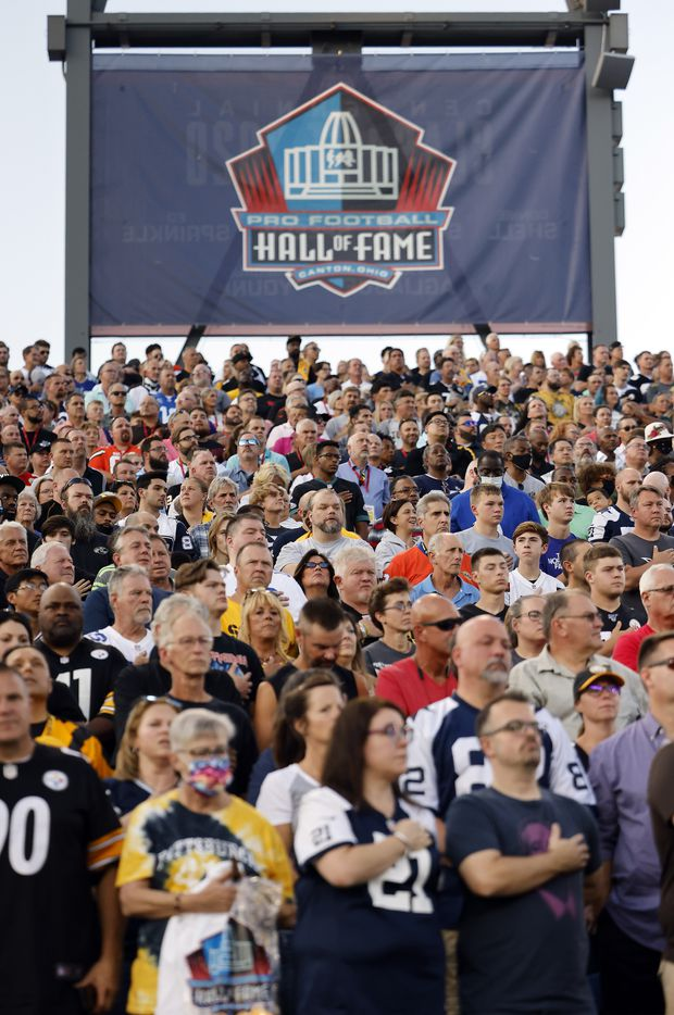 NFL football fans stand for the national anthem before the preseason game between the Dallas Cowboys and Pittsburgh Steelers at Tom Benson Hall of Fame Stadium in Canton, Ohio, Thursday, August 5, 2021. (Tom Fox/The Dallas Morning News)