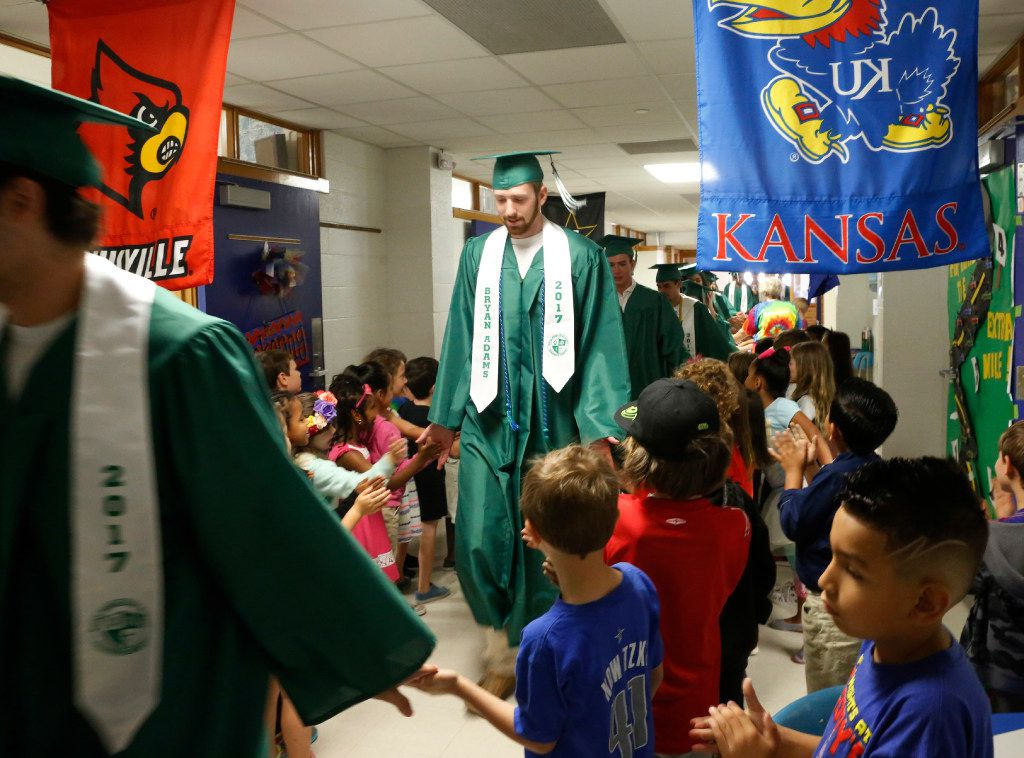 Bryan Adams High School senior Kirby Lohrengel and classmates walked through the halls of Hexter Elementary School on May 26 as the school's staff and students honored alumni.