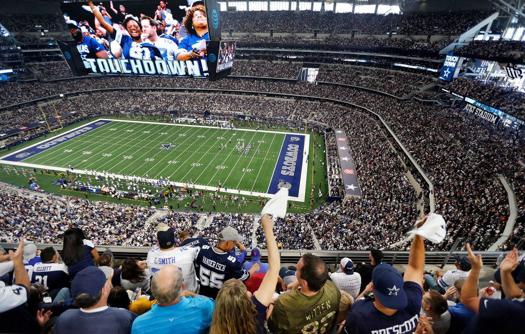 FILE — Dallas Cowboys fans cheer tight end Blake Jarwin's first quarter touchdown against the New York Giants at AT&T Stadium in Arlington, Texas, Sunday, September 8, 2019.