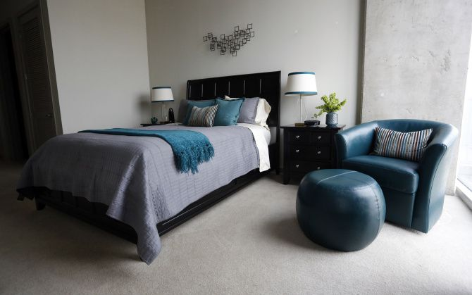 The designer talked her client down from a king-size bed to a queen to allow bedside tables and a chair from Pier 1. A sheet set and coverlet, $99.99 each, are from Bed, Bath & Beyond.
