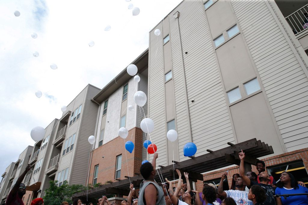 Balloons are released during a vigil for Malik Tyler near the scene of the shooting in Dallas on Wednesday, June 5, 2019. Tyler was injured and killed in crossfire in the 9400 block of Bruton Road Tuesday night. (Vernon Bryant/The Dallas Morning News)