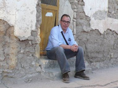Alfredo Corchado sits outside his grandmother's home, where he was born in Durango state. As a journalist in Mexico, he has received multiple death threats, including one in 2007 — the last time he felt safe reporting from the country.