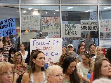 Community members on both sides of the masking debate gather during a Plano ISD emergency meeting regarding mask mandates at the Plano District Administration Building Board Room in Plano, TX, on Aug. 23, 2021.  (Jason Janik/Special Contributor)