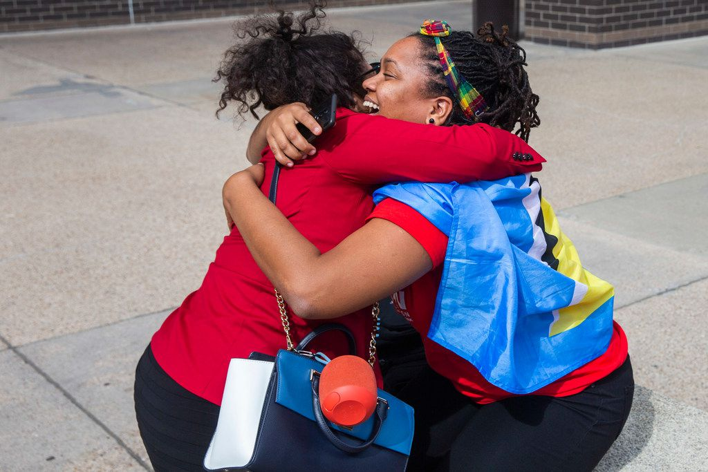 Outside the courthouse, St. Lucian activist Safiya Paul (right) embraces Jennifer Cortez, who lived in the same apartment complex as Botham Jean.