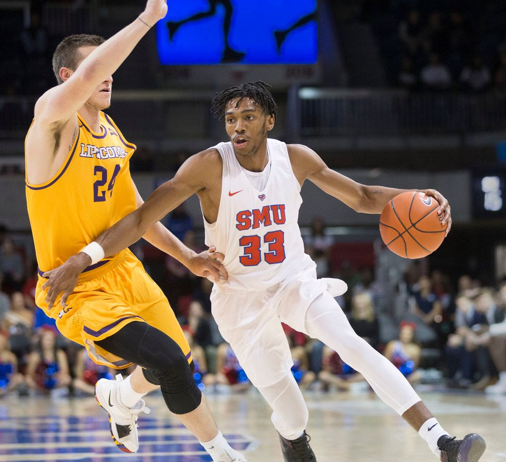 Bisons guard Garrison Mathews tries to block as Mustangs guard Jimmy Whitt Jr. (33) makes a push toward the basket  during the Southern Methodist University Mustangs playing the Lipscomb University Bisons in a college basketball game at Moody Coliseum in Dallas on Saturday, November 17, 2018. (Daniel Carde/The Dallas Morning News)