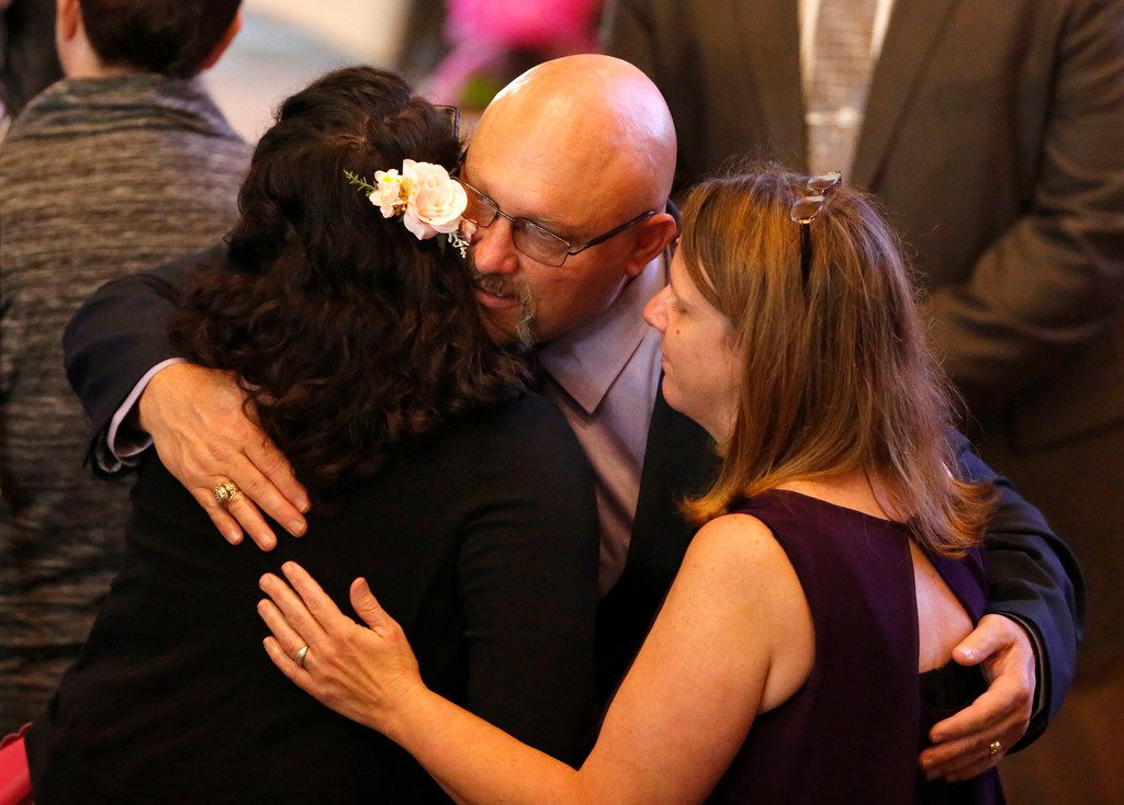 Pastor of First Baptist Church of Sutherland Springs Frank Pomeroy and his wife Sherri, right, recieve hugs during Funeral Services for Annabelle Pomeroy at First Baptist Church of La Vernia in La Vernia, Texas on Nov. 13, 2017. Annabelle was killed in the First Baptist Church in Sutherland Springs, Texas the site of a shooting that killed 26 parishioners and left 30 injured. (Nathan Hunsinger/The Dallas Morning News)