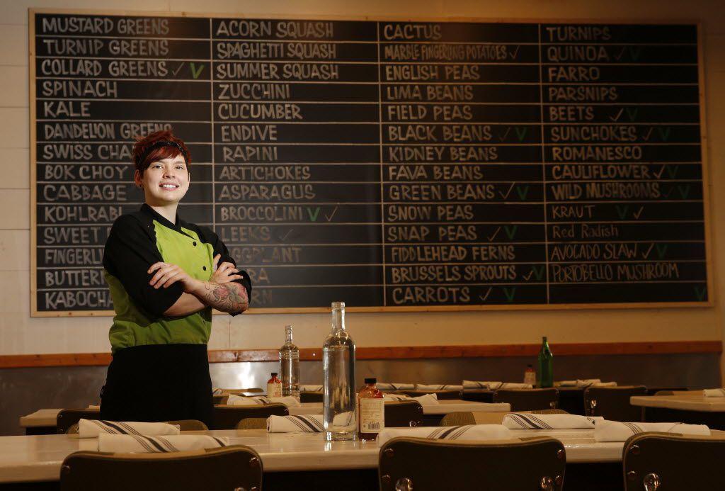 "Mudhen chef Jennifer ""Suki"" Otsuki poses with the restaurant's list of produce."