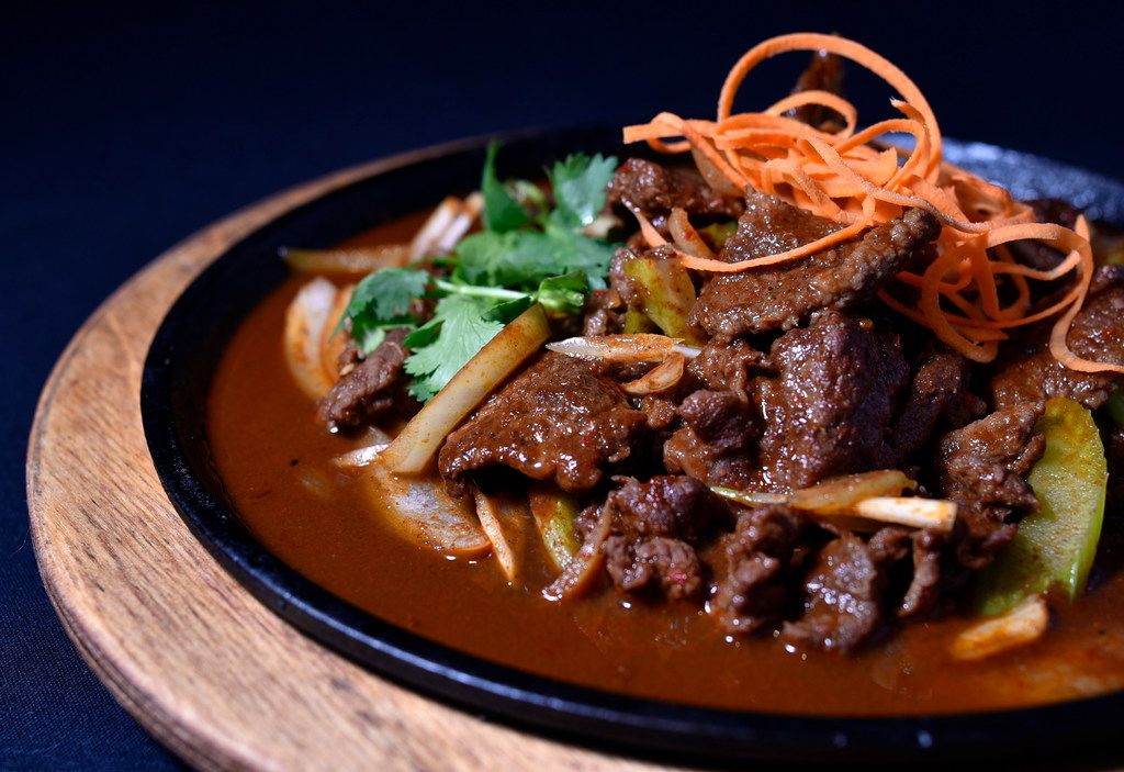 Cumin lamb with onions, bell peppers seasoned with soy sauce and cumin, from Royal China in Dallas
