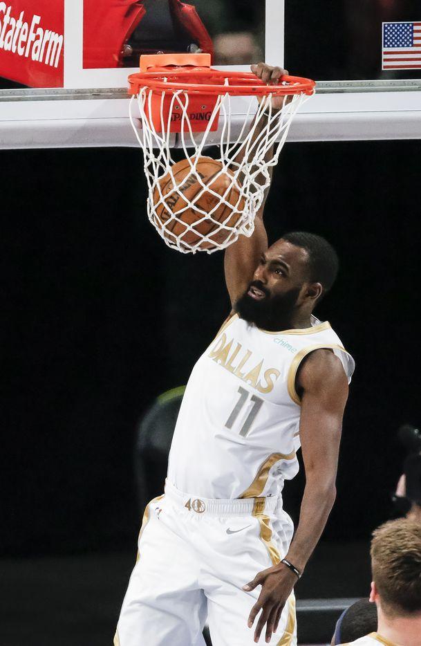 Dallas Mavericks forward Tim Hardaway Jr. (11) dunks during the first half of an NBA basketball game against the Utah Jazz in Dallas, Monday, April 5, 2021. (Brandon Wade/Special Contributor)