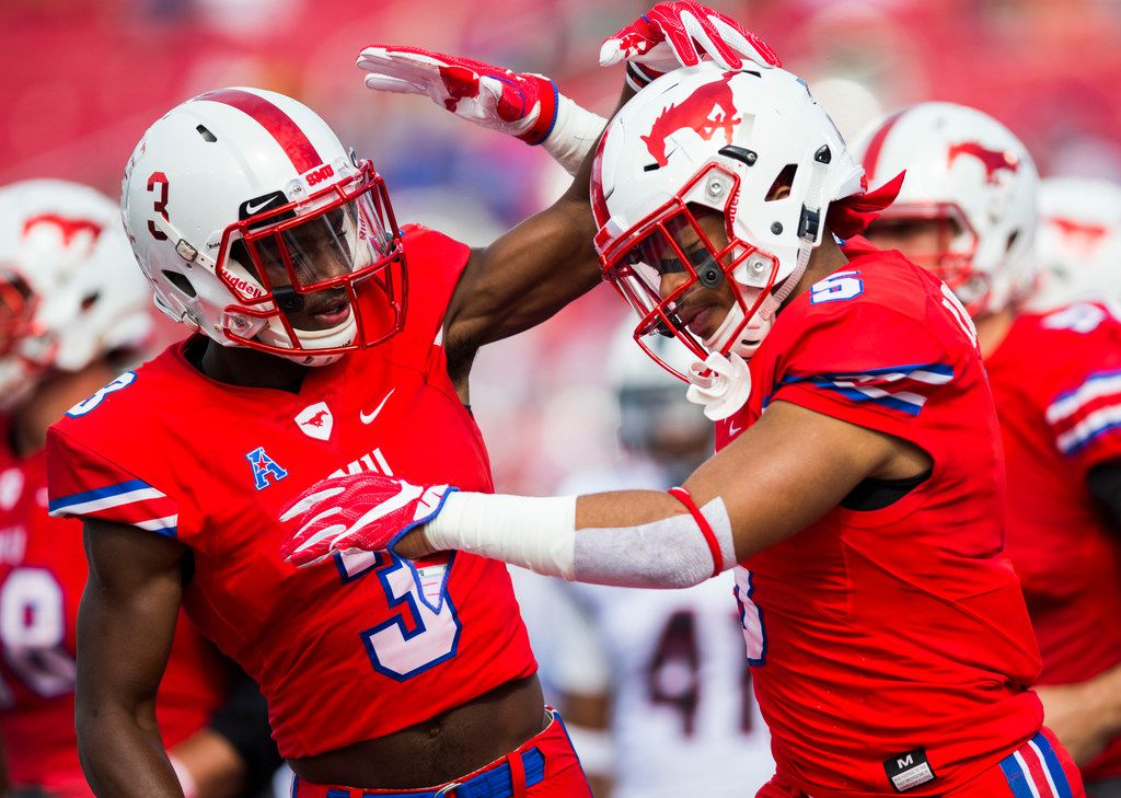 Southern Methodist Mustangs running back Xavier Jones (5) and wide receiver James Proche (3) celebrate after Jones scored a touchdown during the second quarter of a football game between the University of Connecticut and SMU Texas on Saturday, September 30, 2017 at SMU's Ford Stadium in Dallas. (Ashley Landis/The Dallas Morning News)