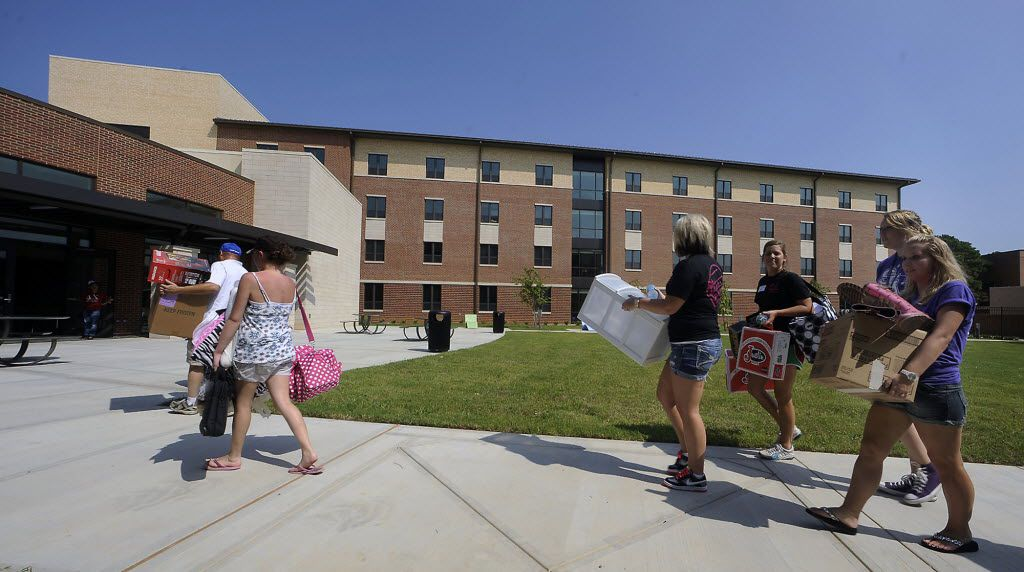 Freshman students and their families haul belongings into the new, $26.7 million Lumberjack Landing freshman dormitory on Aug. 26, 2011, at Stephen F. Austin State University in Nacogdoches. The university dedicated the new dorm, along with three existing residence halls, to house freshmen to promote unity and increase freshman retention rates.