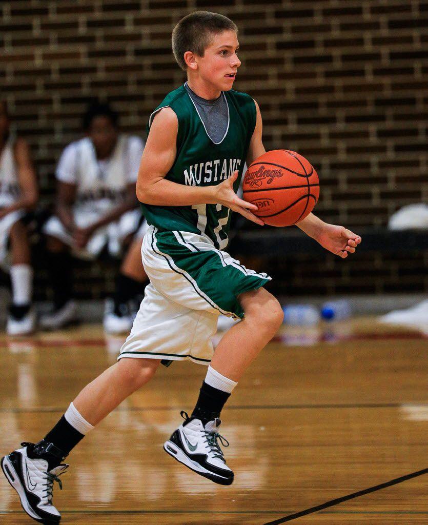 Shane Buechele playing basketball