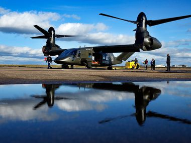 The V-280 Valor tilt-rotor, a next-generation aircraft that Bell wants to build for the U.S. military, was reflected in rain water after demonstrating its skills at the Bell Flight Research Center in Arlington this week.