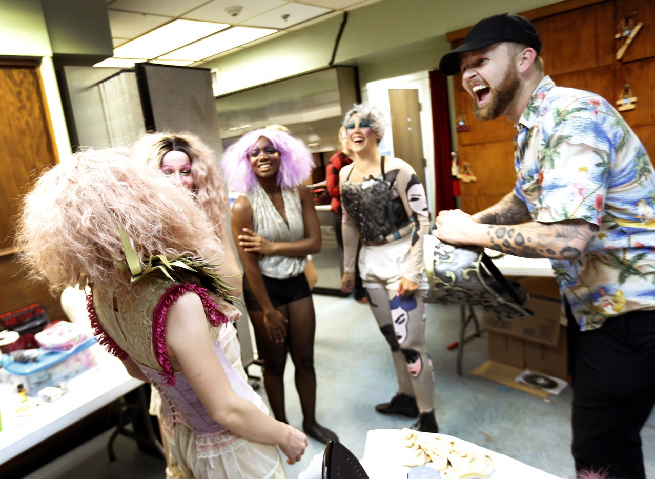 Costume designer Victor Brockwell (right) and members of the Pippin cast share a laugh backstage during dress rehearsal.