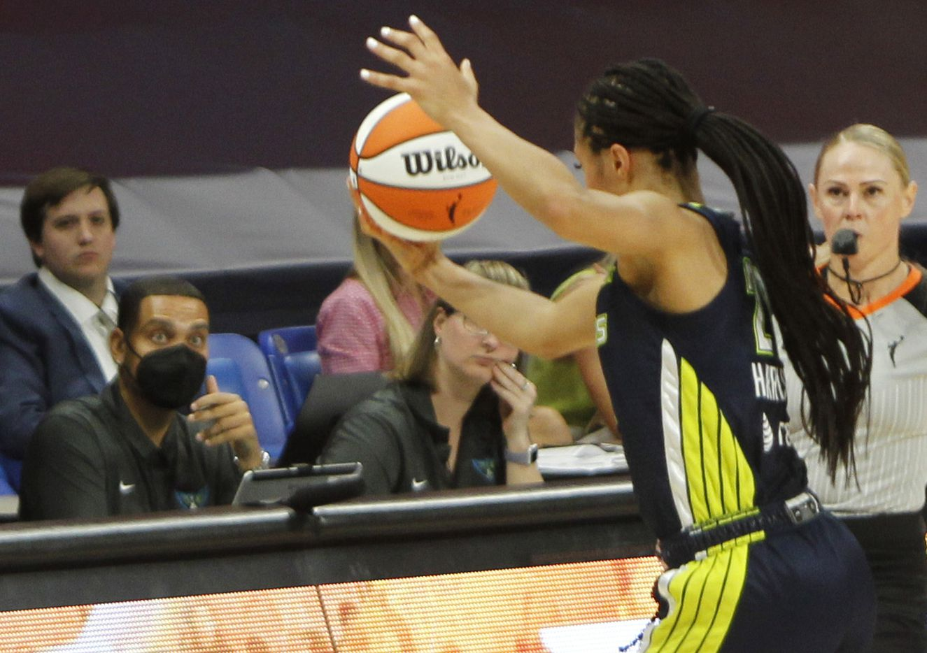 Dallas Wings forward Isabelle Harrison (20) reaches to keep the ball in play during second half action against the Chicago Sky. Dallas lost to Chicago 91-81. The two WNBA teams played their game at College Park Center in Arlington on June 30, 2021. (Steve Hamm/ Special Contributor)