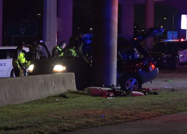 Fort Worth police examine an SUV that struck a sign pillar Wednesday night in a crash that killed a 20-year-old woman.