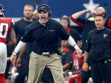 Atlanta Falcons head coach Dan Quinn celebrates after his defense sacked Dallas Cowboys quarterback Brandon Weeden (3) to force Dallas to punt during the second half of play at AT&T Stadium in Arlington on Sunday, September 27, 2015.