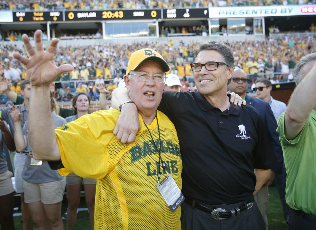 Baylor Bears president Ken Starr and Texas Governor Rick Perry prior to the start of the inaugural game between Baylor University and Southern Methodist University at McLane Stadium in Waco on Sunday, August 31, 2014.
