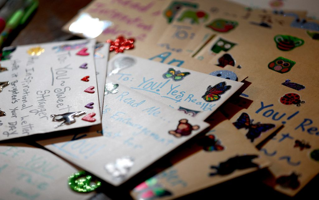 Cards that Angela Joy Bailey wrote sit on the table at her grandparents' home.