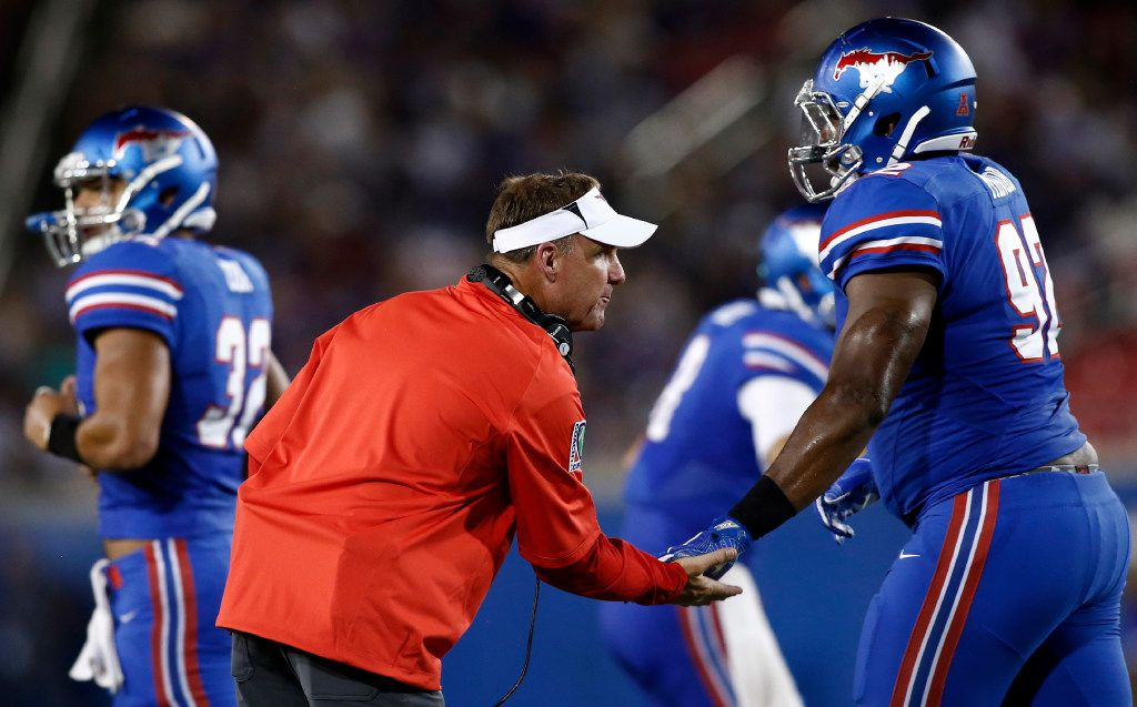 SMU head coach Chad Morris congratulates defensive end Zelt Minor (92) after stopping TCU in the first half of an NCAA college football game, Saturday, Sept. 23, 2016, in Dallas, Texas. TCU defeated SMU 33-3. (AP Photo/Mike Stone)