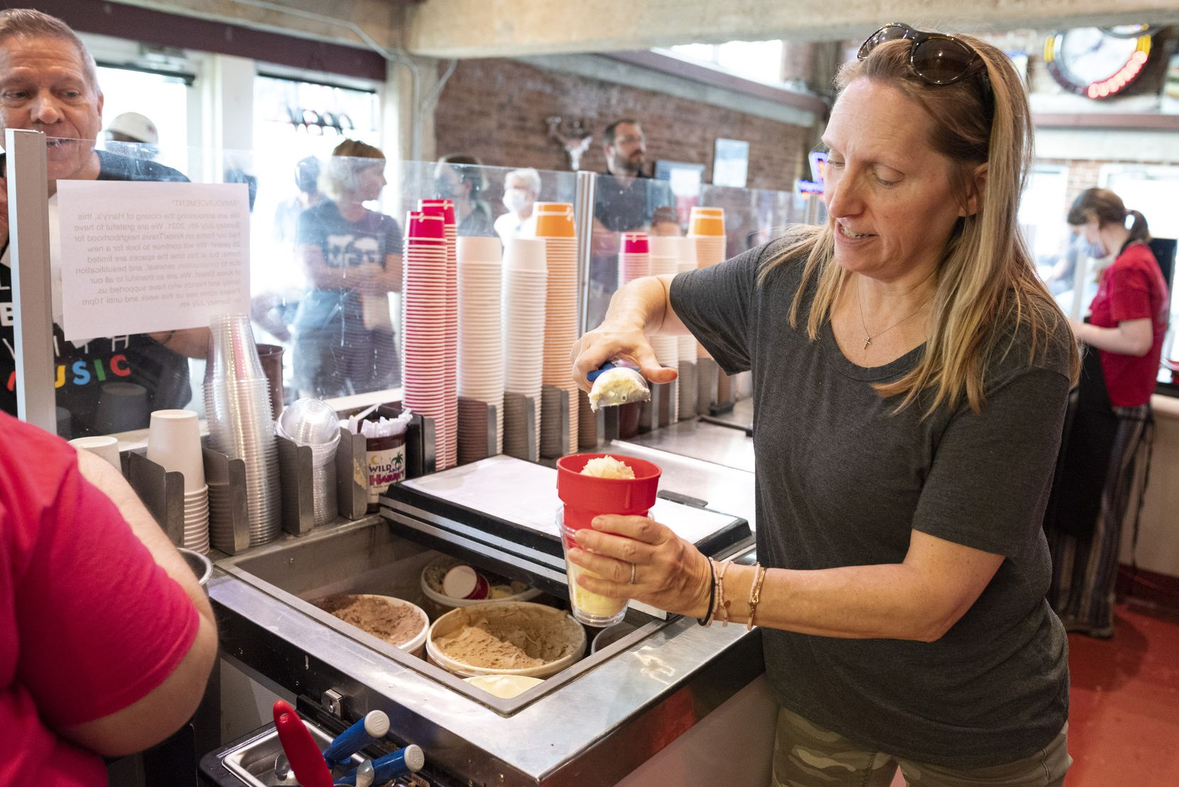 President of operations Sydney Coley-Berglund prepares a vanilla concrete with Oreos at Wild About Harry's in Dallas on June 30, 2021.