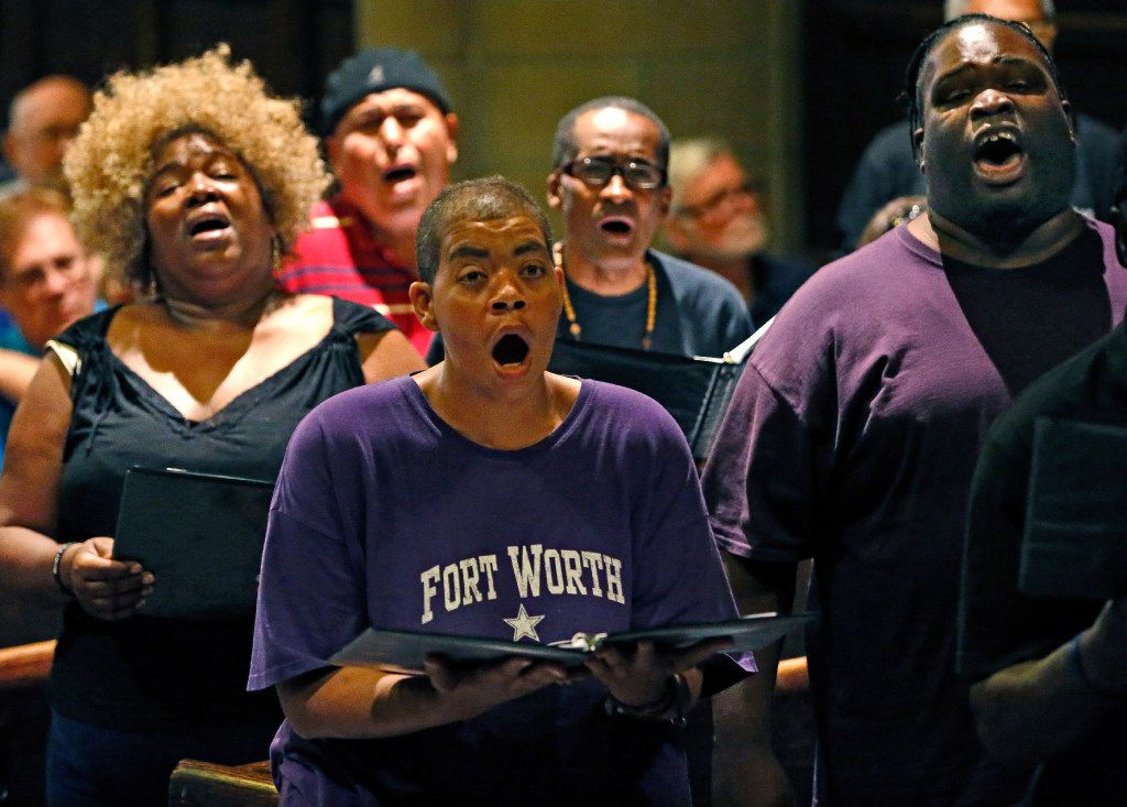 Members of the Dallas Street Choir Debra Scott, left rear, Elizabeth Armstrong, center, and Toria Ellis, far right, raise their voices during a rehearsal for their performance at Carnegie Hall on Wednesday evening, at the Fifth Avenue Presbyterian Church in New York.