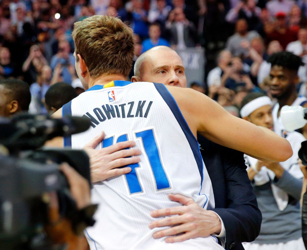 Dallas Mavericks forward Dirk Nowitzki (41) is congratulated by head coach Rick Carlisle after making his 30,000 point against the Los Angeles Lakers in the second quarter at the American Airlines Center in Dallas, Tuesday, March 7, 2017. Dirk is only the 6th player in NBA history to reach the milestone. (Tom Fox/The Dallas Morning News )