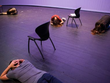 Cast members lay on the floor while practicing the opening scene of Shots Fired on June 30 at Eastfield College in Mesquite. Put on by Cry Havoc Theater, a group of high school students from multiple schools, Shots Fired is a documentary theater production about the July 7 police shooting. The show opens for its second run on July 7, the first anniversary of the shooting. (Ryan Michalesko/Staff Photographer)