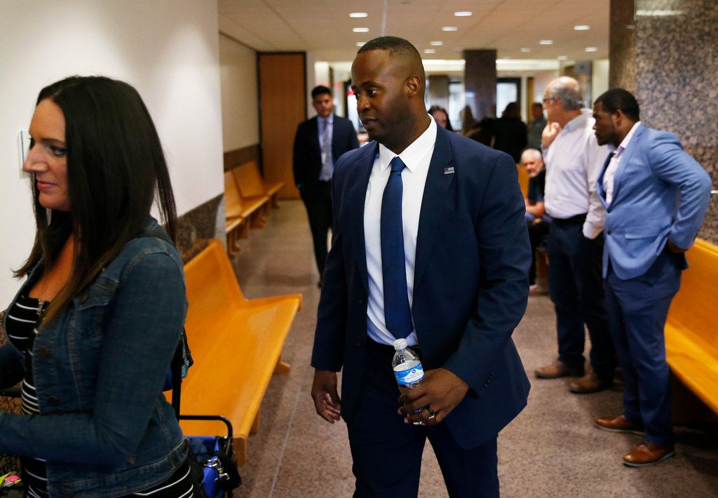 Former Mesquite police Officer Derick Wiley makes his way to the courtroom during his second trial in the shooting of Lyndo Jones on Friday at Dallas' Frank Crowley Courts Building.