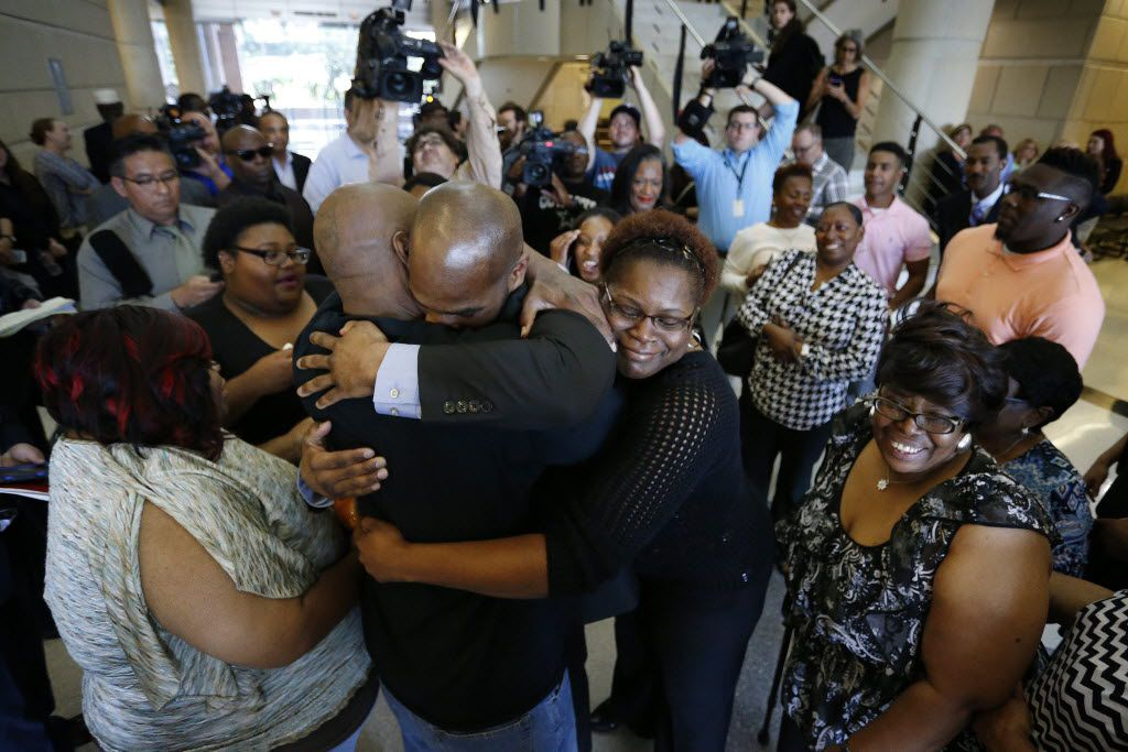 John Nolley (center, facing camera) was embraced by his brother LaMarcus Nolley and sister Mia Nolley after he was released from prison in 2016.