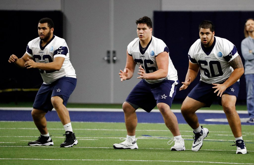 Dallas Cowboys rookies Larry Allen Jr., from left, Connor McGovern and Derrick Puni, right, participate in drills during the NFL football team's minicamp in Frisco, Texas, Friday, May 10, 2019. (AP Photo/Tony Gutierrez