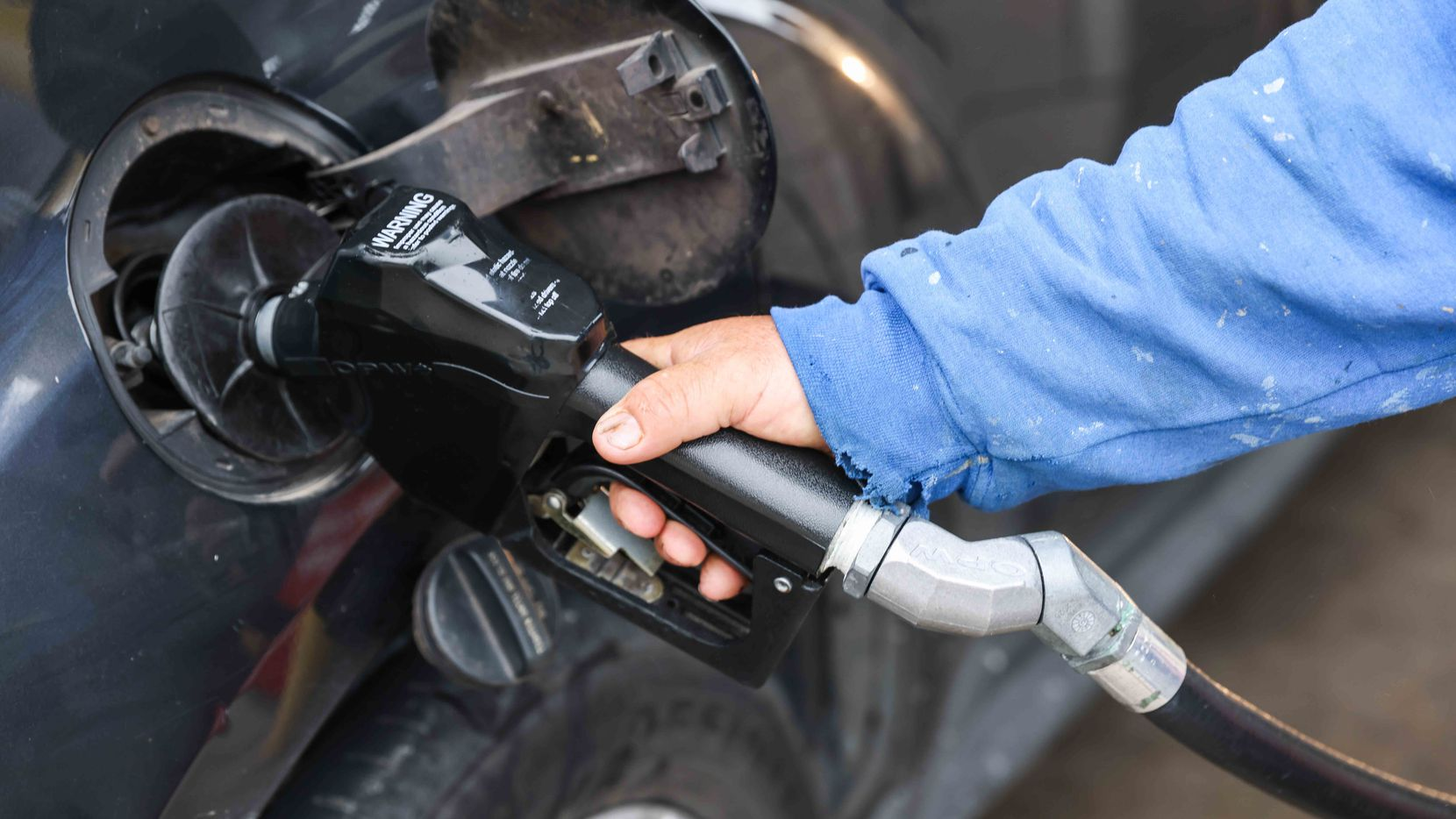 Ignacio Vazquez put gas in his vehicle at the Sam's Club gas station on Retail Road in Dallas in May.