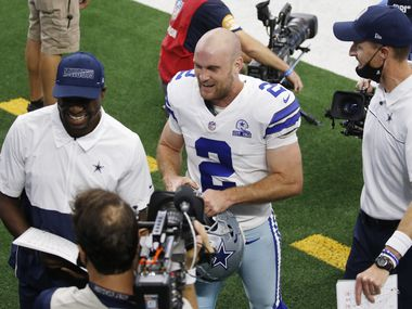 Dallas Cowboys kicker Greg Zuerlein (2) smiles as he exits the field with Dallas Cowboys special teams coordinator John Fassel after defeating the Atlanta Falcons 40-39 in the home opener at AT&T Stadium in Arlington, Texas on Sunday, September 20, 2020.