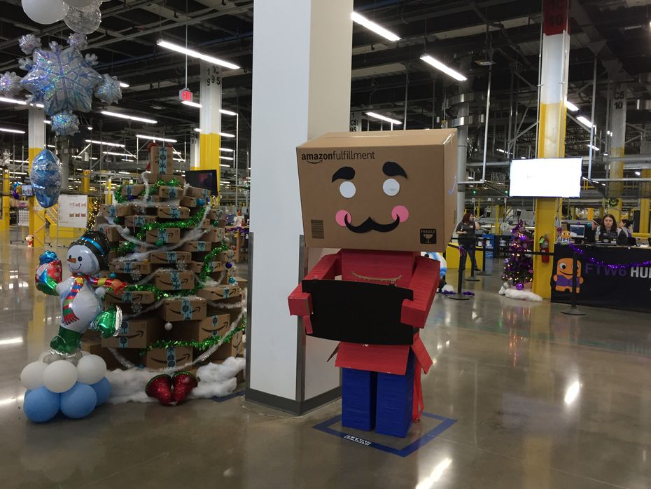 It's a tradition at Amazon fulfillment centers to have box men greeters during the holidays.