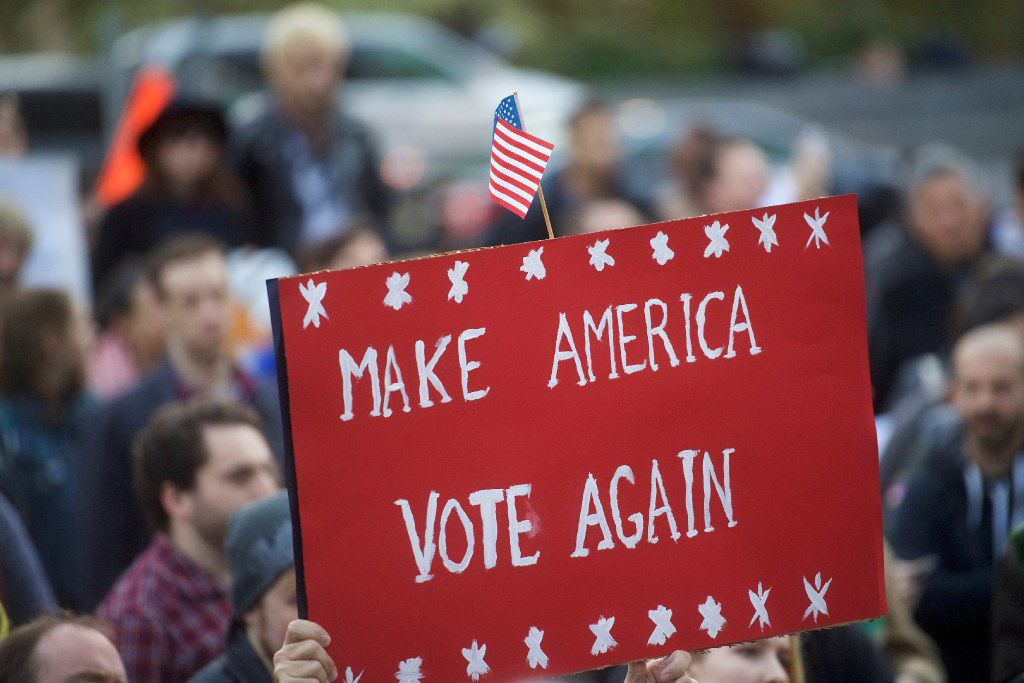 PHILADELPHIA, PA - NOVEMBER 13:   Protestors demonstrate against President-elect Donald Trump November 13, 2016 in Philadelphia, Pennsylvania.  The Republican candidate lost the popular vote by more than a million votes, but won the electoral college.  (Photo by Mark Makela/Getty Images)