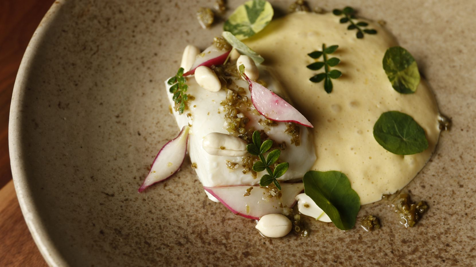 Warm halibut with savory sabayon, pickled sea bean relish, shaved radishes and green peanuts. Dallas' new Uchi is not merely a pretty good outpost of Tyson Cole's original in Austin, but a brilliant destination in its own right.