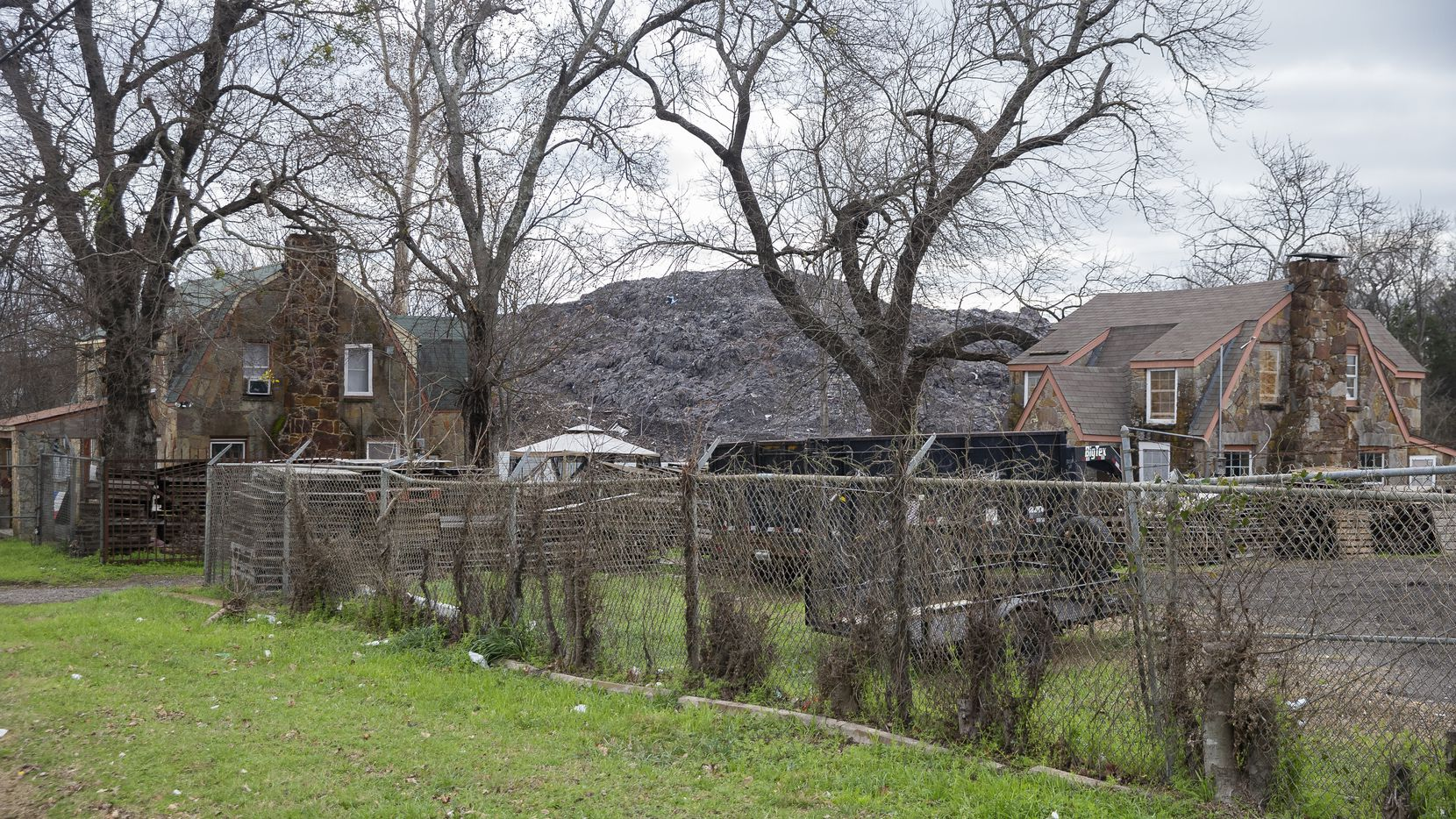 The mountain of roofing shingles at Blue Star Recycling off South Central Expressway in February 2020.