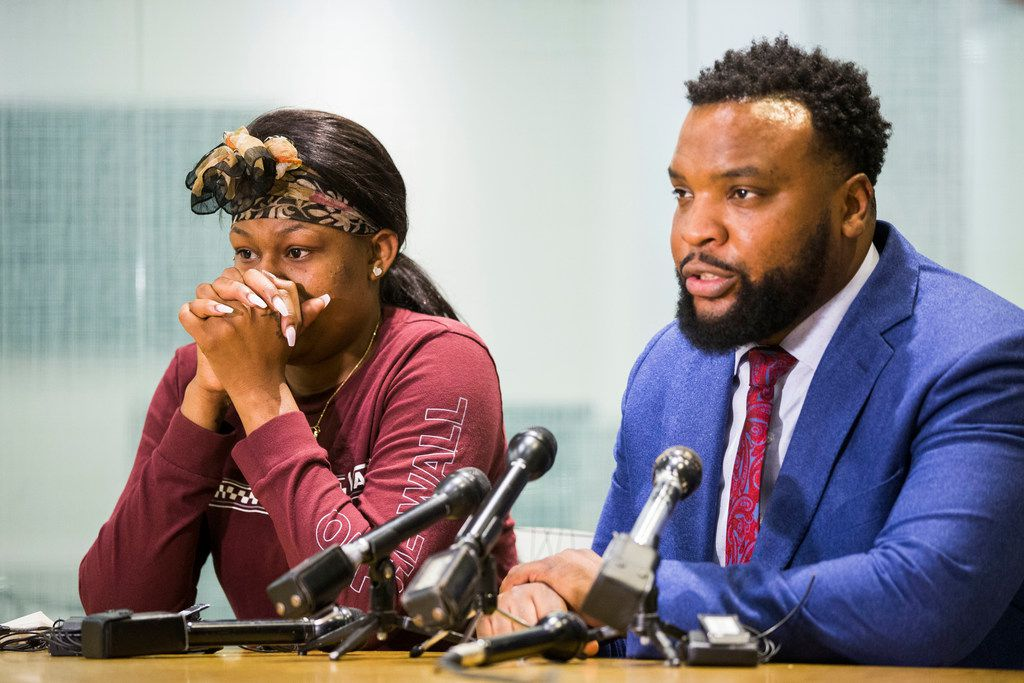 L'Daijohnique Lee appeared with her lawyer, Lee Merritt, during a news conference March 25.