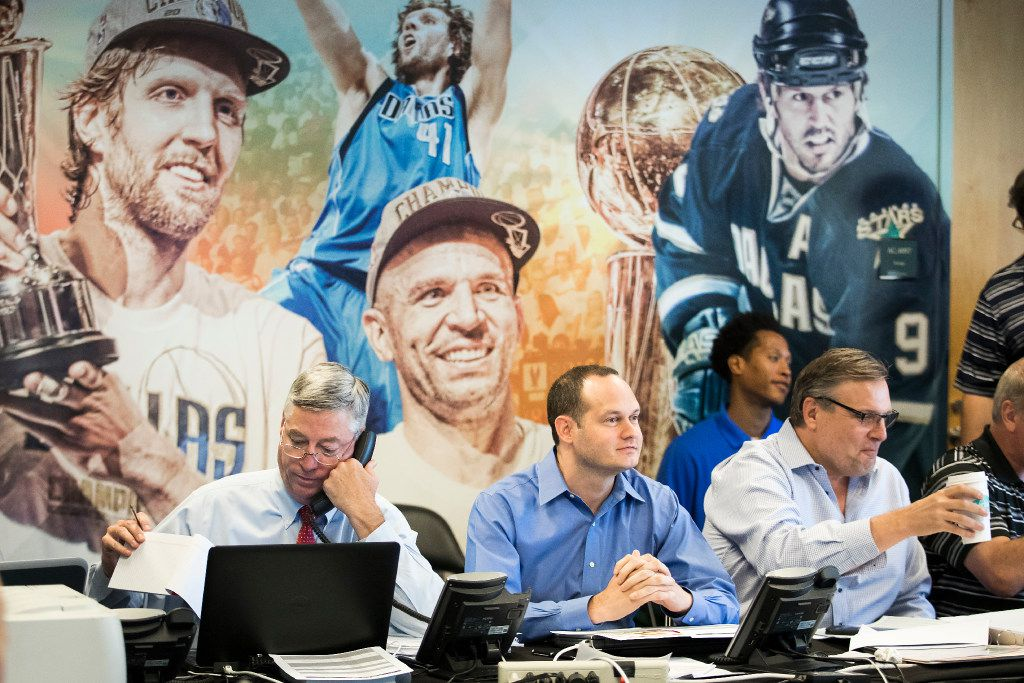 """From left: Dallas Mavericks assistant general manager Keith Grant,  director of scouting Jason White and president of basketball operations and general manager Donnie Nelson work in the team's """"war room"""" during the NBA Draft at American Airlines Center on June 22, 2017, in Dallas."""