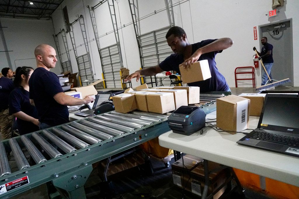 Frank Codispoti and Dupree Nobles prepare packages at ShipBob in Grapevine, November 2, 2017. The 3-year old company is expected to hire up to 40 people during the holiday season.