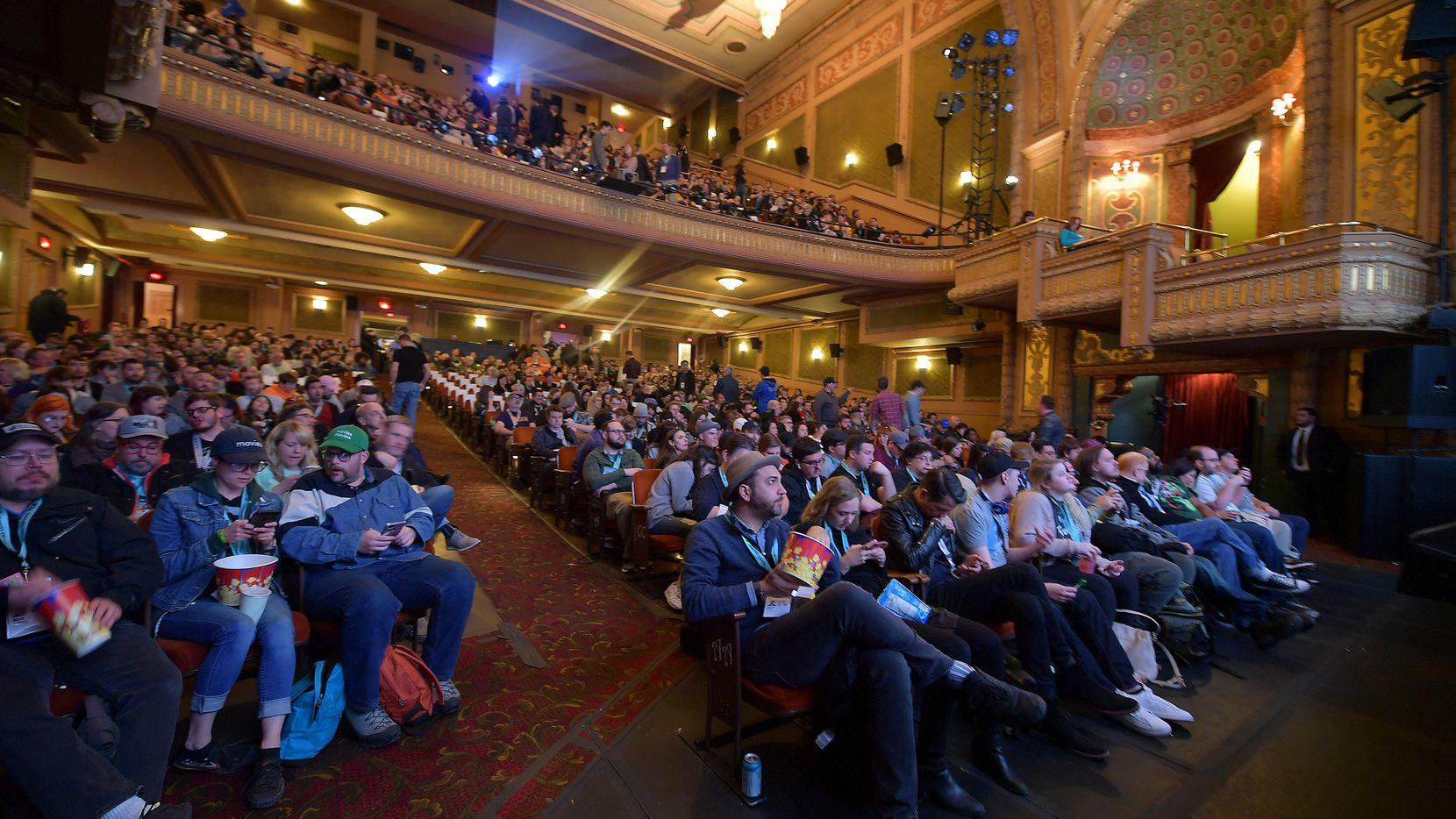 In this file photo from the SXSW Conference in March, 2019, an audience views the 'Pet Sematary' premiere at the packed Paramount Theatre  in Austin, Texas.