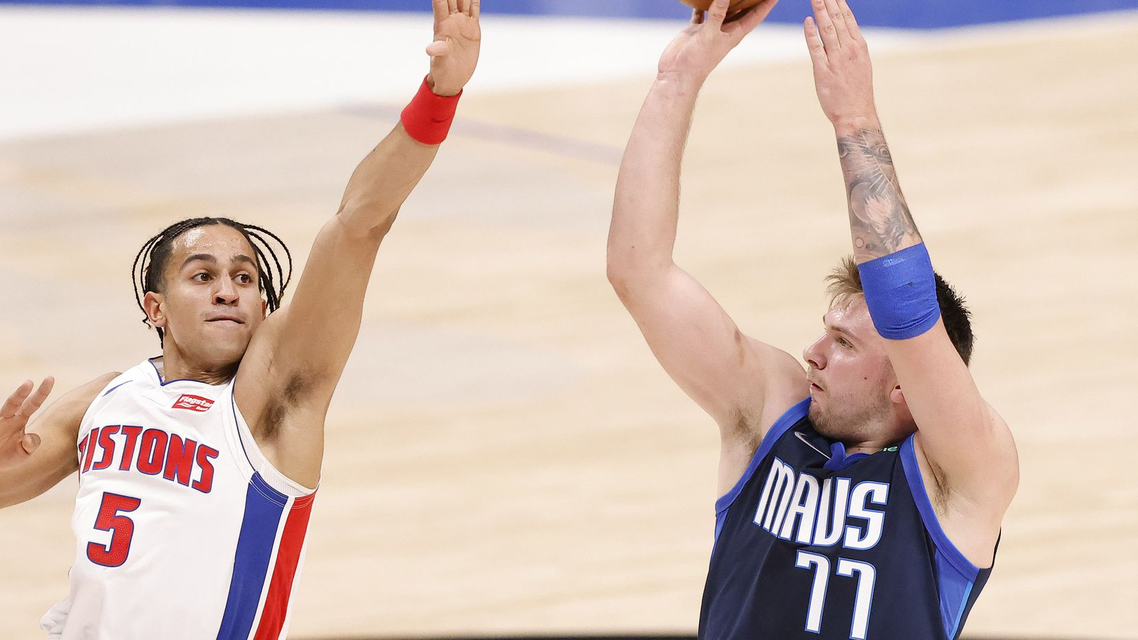 Dallas Mavericks guard Luka Doncic (77) puts up a there-pointer against Detroit Pistons guard Frank Jackson (5) in the second quarter at the American Airlines Center in Dallas, Wednesday, April 21, 2021.