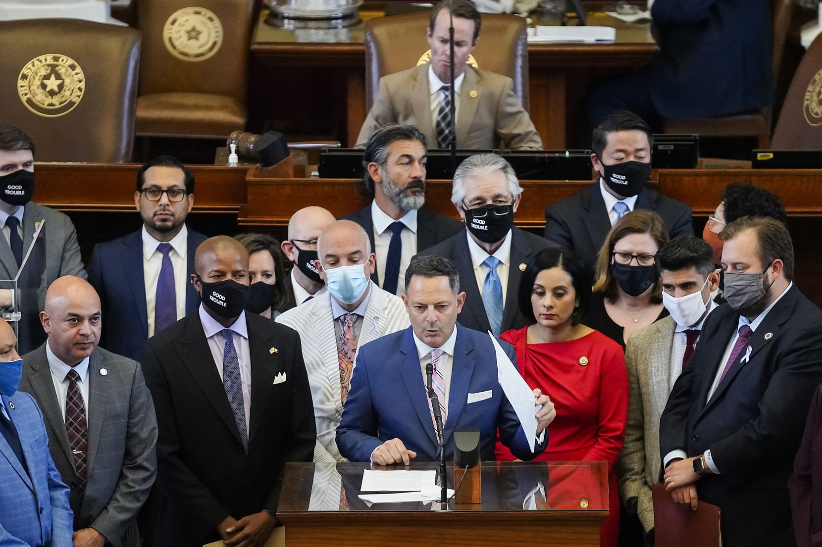Democrats gather around Rep. Rafael Anchía, D-Dallas, as he speaks in opposition to SB-7 on the floor of the House Chamber at the Texas Capitol during the 87th Texas legislature on Friday, May 7, 2021, in Austin. (Smiley N. Pool/The Dallas Morning News)