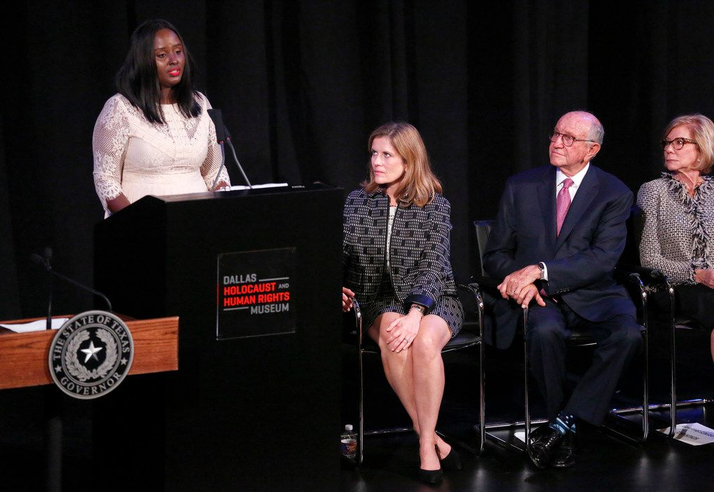 Lydia Nimbeshaho delivers an emotional speech about her experiences as a survivor of the Rwandan genocide. She was joined on stage by (from left) museum CEO Mary Pat Higgins, major donor Nate Levine and former state Sen. Florence Shapiro, who formerly served as museum board chair.